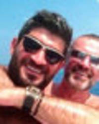 'get in touch': george michael's lover fadi offers to 'tell all' in twitter meltdown