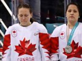 canadian women's hockey player takes off silver medal