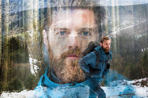 There's a rugged Land Rover phone hidden beneath this man's beard
