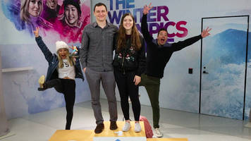 olympic gold medalist chloe kim and jimmy fallon photobomb olympic fans - and she finds out she's made it onto a box of kellogg's corn flakes.