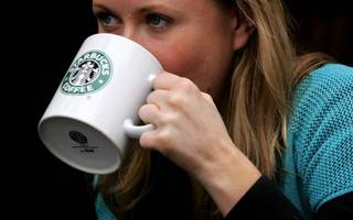 """starbucks' trial """"latte levy"""" starts in the city today"""