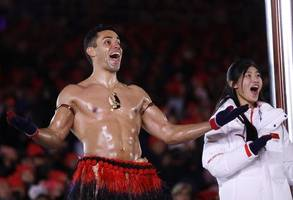 shirtless tongan marches shirtless again at the olympics' closing ceremony. because he is the shirtless tongan