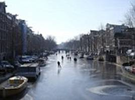 Skaters take to Amsterdam's famous canals after they freeze over