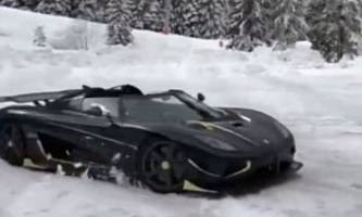 gold-trimmed koenigsegg agera rs naraya does donuts in the snow