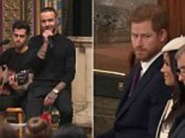 prince raises his eyebrows to meghan after liam payne's performance