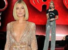hailey baldwin dons glittering ensembles as iheartradio awards host