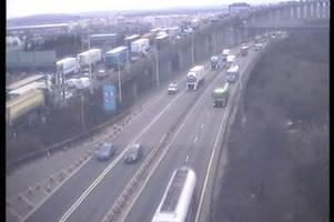 diversion at m25 dartford crossing after emergency services close road following lorry crash
