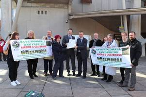 protestors against greenbelt housing development hand over petition at holyrood