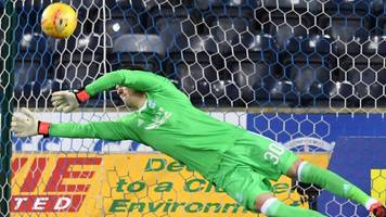 woodman saves three shoot-out penalties in aberdeen cup victory