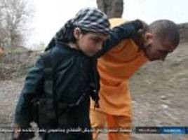 isis forces two young boys to help execute captured afghans