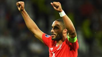 ashley williams: defender to continue as wales captain under giggs