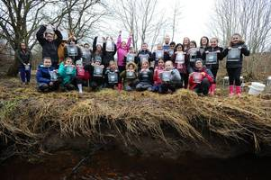 West Lothian primary school pupils release trout into the wild after rearing them