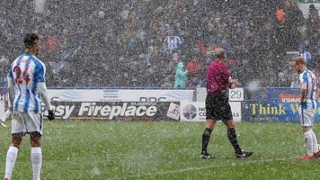 snow storms hit premier league grounds