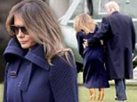 Melania Trump trips on White House lawn, caught by President Trump