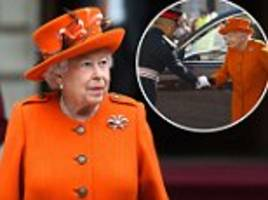 queen wears bright orange to visit the royal academy of arts