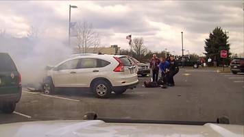 'heroes' save trapped man from burning car