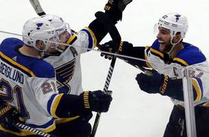 blues host bruins riding momentum from two overtime wins