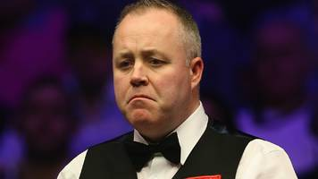 players championship: john higgins out but judd trump through