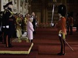 queen looks dainty in pink as she inspects grenadier guards