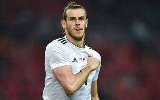 bale breaks wales scoring record in giggs's first game