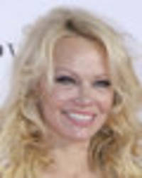 pamela anderson ditches bra in very clingy silk gown for eye-popping display