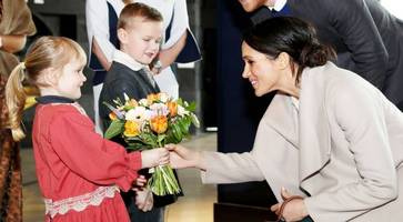 meghan and harry visit northern ireland: playful hint at possible royal baby generates huge excitement
