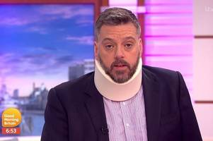 iain lee wears neck brace on good morning britain after 'falling down a well'