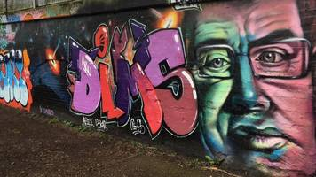 cambridge college 'touched' by hawking graffiti