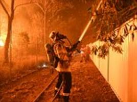 sydney bushfire spreads towards nuclear reactor and army base as residents nearby are evacuated