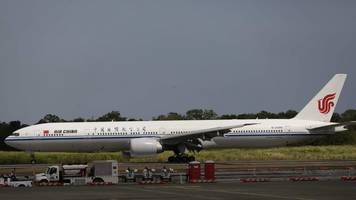 air china plane 'pen' hostage drama suspect held by police