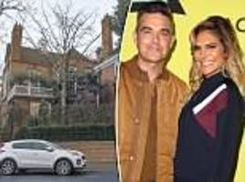 robbie williams' wins battle with neighbours to extend his home