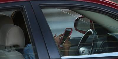 people using their phones while driving is a huge problem, but a new iphone feature is helping (aapl)