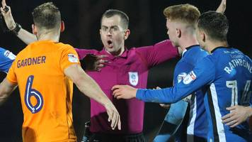 fan arrested after running at referee in rochdale-oldham derby