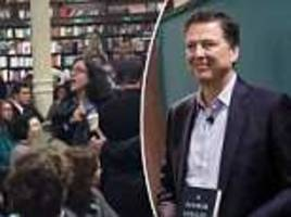 James Comey is heckled by protesters in New York