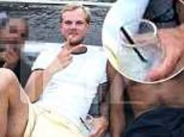 avicii poses with cocktail on yacht one day before death as police determine 'no criminal suspicion'