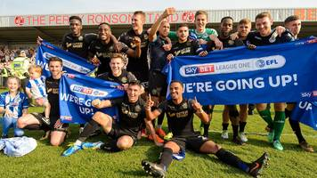wigan promoted back to championship after thrashing fleetwood