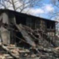 firefighters had to hold back single mother as she watched her missouri home burn to the ground with her four sons inside