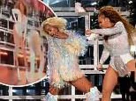 beyonce tries to pick up sister solange on stage and falls during second performance of coachella