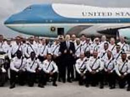 president donald trump poses up with law enforcement officers in front of air force one