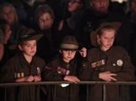thousands of people line the streets to salute our veterans as they march to mark anzac day