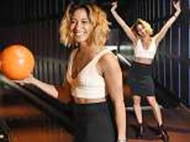 Strictly's Karen Clifton shows off her washboard abs in London