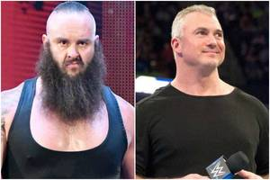 wwe's braun strowman hurls shane mcmahon through announce table from ring (video)