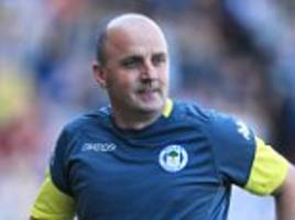 wigan look to tie down manager paul cook to a new contract