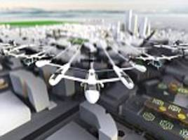 uber unveils its self-flying taxi: firm shows off the first look at prototypes for uber air craft