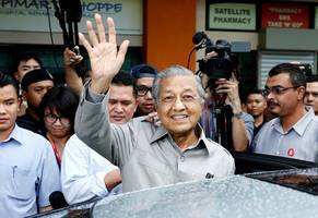 malaysia's currency gets smoked as the country's opposition leader declares victory in the presidential election