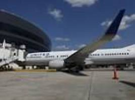 nigerian mom-of-two sues united airlines claiming she was kicked off plane because of 'pungent' odor