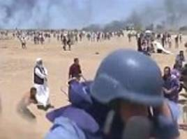 al jazeera journalist narrowly avoids being shot by a sniper and hit by drone-fired tear gas grenade