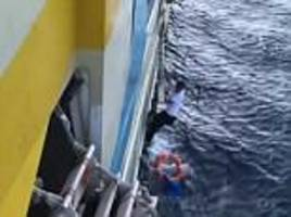 dramatic moment woman is rescued after she is spotted floating in the mediterranean