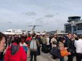fire alarm blares at london city airport whilst passengers wait on runway