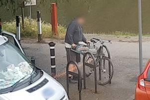 dramatic video shows man use angle grinder to slice off bike lock in broad daylight